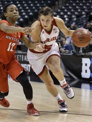 Nebraska Cornhuskers guard Natalie Romeo (5) drives around Rutgers Scarlet Knights guard Khadaizha Sanders (12) in the second half of their Big Ten Women's Basketball Tournament game Thursday, Mar 3, 2016, at Bankers Life Fieldhouse in Indianapolis. The Rutgers Scarlet Knights defeated the Nebraska Cornhuskers 66-63.