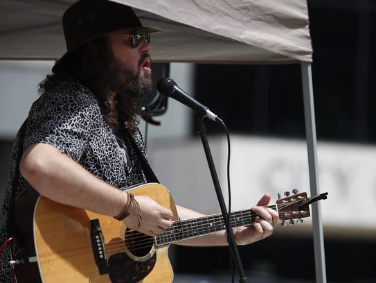 Benjamin Olson performs in Houdini Plaza for Lunchtime