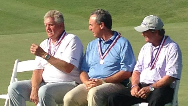 West Des Moines' Mike McCoy, center, was the low amateur at the U.S. Senior Open this week. He's pictured with winner Colin Montgomerie, left, and runner-up Gene Sauers.