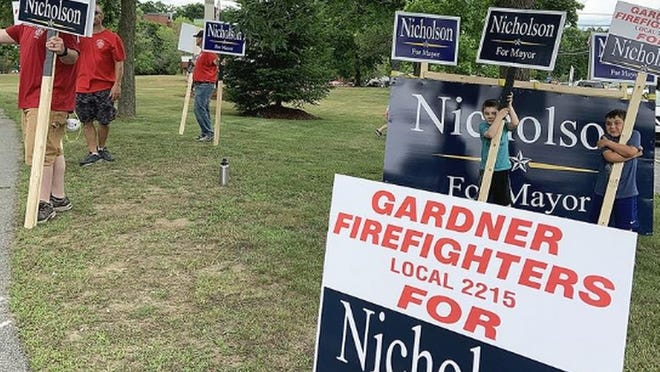 Supporters of Michael Nicholson lined Monument Park in Gardner on Tuesday.