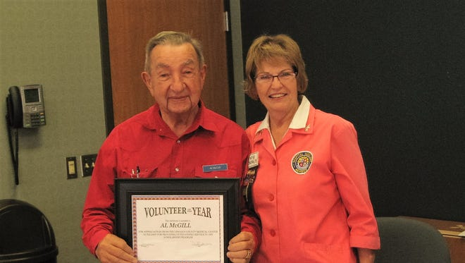 Pictured, is Volunteer of the Year nominee Al McGill and LCMC Auxilliary Vice President Marilyn Beckley.
