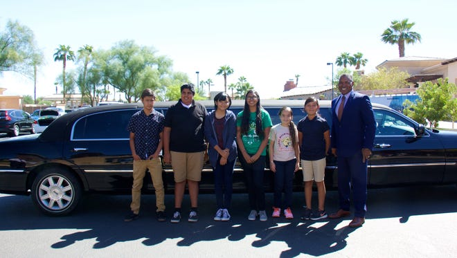 These students with perfect attendance in the Coachella Valley Unified School District were treated to a limousine escort to lunch. They are (left to right)  Rogelio Zepeda, Mario Zamora Urbina, Yasmin Adolfo, Anika Acosta, Irma Felix, and Zamara Cervantes with superintendent Darryl Adams.