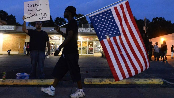 Demonstrators in Ferguson, Mo., on Monday.