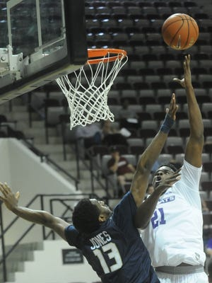 ACU's Jalone Friday, right, shoots over Charleston Southern's Jordan Jones in the first half. The Buccaneers beat ACU 66-65 in a nonconference game Tuesday, Nov. 22, 2016 at Moody Coliseum.