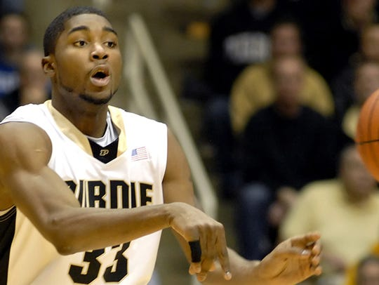 Purdue guard E'Twaun Moore passes the ball against