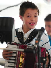 Nick Vinecki plays accordian in the band called Box On, featuring his parents and seven siblings, during Pulaski Polka Days.