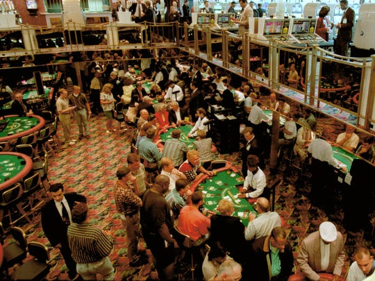 FILE - In this June 3, 1996, file photo, gamblers fill the tables on two decks during a practice cruise on the Majestic Star Casino in Gary, Ind. Donald Trump's appeal to black voters sounds familiar in Gary, and not in a good way. In 1993, Trump swooped into Gary on his private jet and pledged to make the down-on-its-luck city great again with a riverboat casino along a Lake Michigan shoreline littered with shuttered factories. Little more than a decade later Trump's company declared bankruptcy, leaving behind lawsuits and hard feelings in the majority-black city.