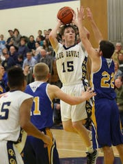 Greencastle-Antrim's Ian Gelsinger (15) takes a shot against Mitch Neterer, of Waynesboro, during a boys basketball game on Tuesday, January 10, 2017. The Blue Devils won, 59-37.