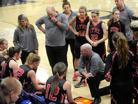 Brandon Valley's head coach Mark Stadem talks with his team after the first quarter during girls basketball action against O'Groman in Sioux Falls, S.D., Tuesday, Dec. 15, 2015.