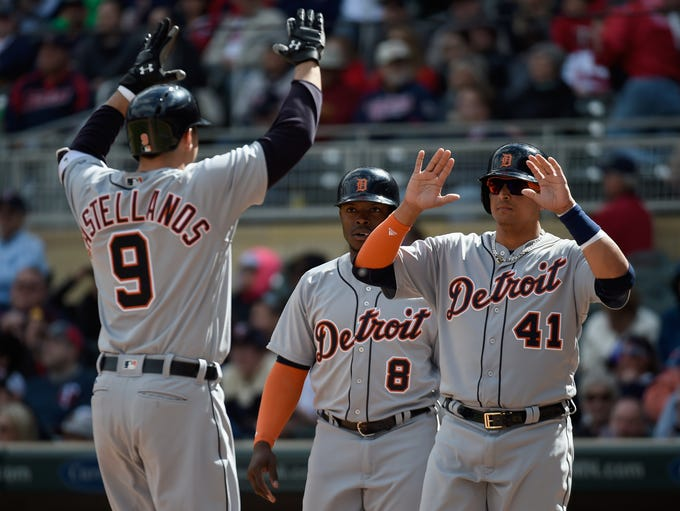 Justin Upton #8 and Victor Martinez #41 of the Detroit