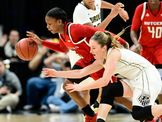 Rutgers Scarlet Knights guard Ciani Cryor (5) steals the ball away from Purdue Boilermakers guard Karissa McLaughlin (1) during the second round of the Big Ten Conference Tournament at Bankers Life Fieldhouse. Rutgers defeated Purdue 62-60.