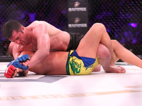 Chael Sonnen controls Wanderlei Silva on the ground during their June 2017 bout at Madison Square Garden in New York.