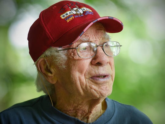 World War II veteran Norbert Jost, 92, talks about his time in the military while waiting to go fishing Saturday, June 30, on Lake Sagatagan in Collegeville.