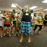"""Ella Noles rehearses her part as Zazu for an upcoming performance of """"The Lion King"""" during a theater camp Wednesday. Campers will peform the play Tuesday at Freed-Hardeman University's Loyd Auditorium."""