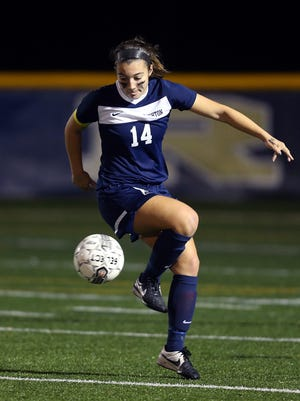 Brighton's Lauren Donnelly tries to control the ball.