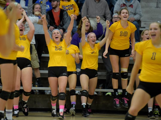 Hagerstown volleyball players celebrate during the volleyball sectional Oct. 22 at Lincoln High School in Cambridge City.
