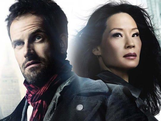 Jonny Lee Miller as Sherlock Holmes and Lucy Lui as