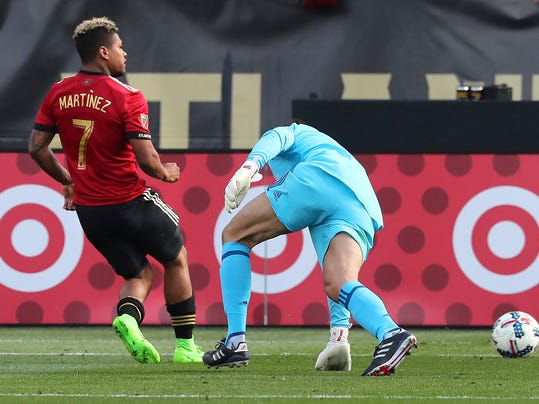 Atlanta United forward Josef Martinez scores his first of two goals past Chicago Fire goalkeeper Jorge Bava, during the second half of an MLS soccer match Saturday, March 18, 2017, in Atlanta. Atlanta won 4-0. (Curtis Compton/Atlanta Journal-Constitution via AP)