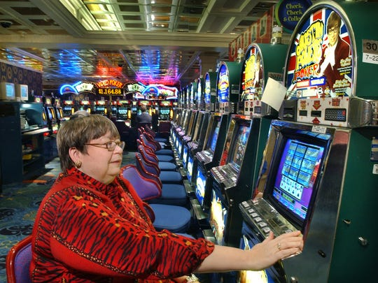 In this January 2005 photo, Bonnie Britton tries her luck at the 25-cent Austin Powers video poker machine at the Argosy riverboat casino in Lawrenceburg, Ind. Britton wrote about the 10th anniversary of casino gambling in the state.