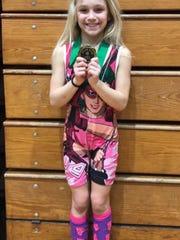 Kylee Trostle won the girls 8U 55-pound girls division