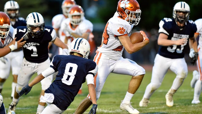 Central York's Will Van Dyke carries the ball in the first half of a YAIAA football game Friday, Sept. 1, 2017, at West York. West York hosted Central York for the first high school football game of the YAIAA season.