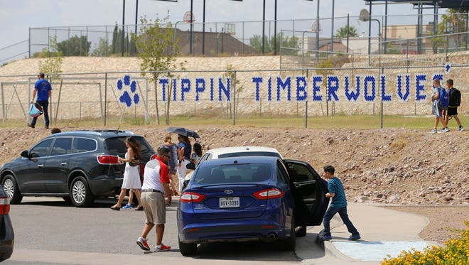 With the exception of a few more El Paso Independent School District police officers watching the flow of traffic and students and parents crossing Bear Ridge Drive at the crooswalks, EPISD officials attempted to have things at Tippin Elementary School back to as normal as possible Tuesday afternoon, after Mondays tragic accident that took the life of a Army veteran nurse and injured three students from the school.