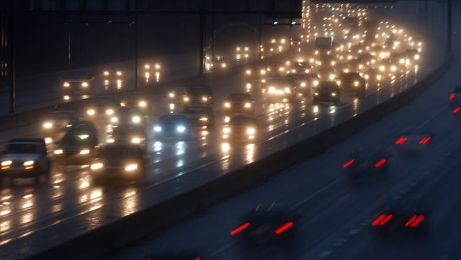 Motorists drive in the rain on Interstate 270 in Rockville, Md., last November.