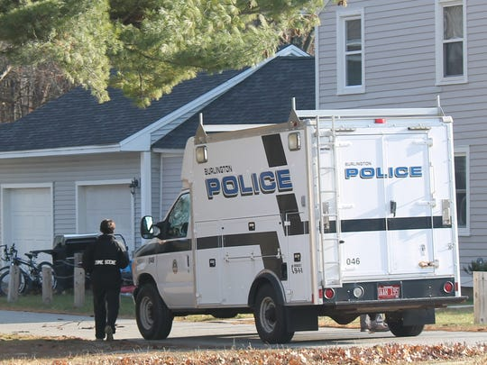 Burlington Police investigators work at a home near Hunt Middle School in the New North End Thursday morning.