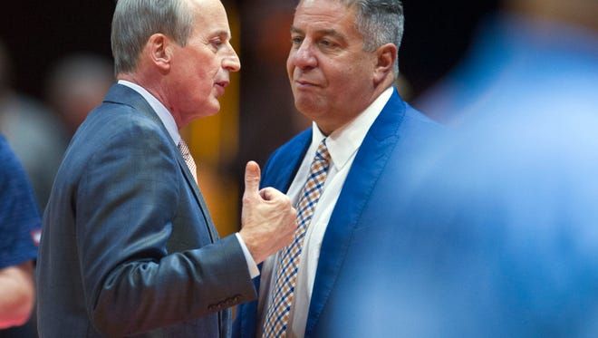 Tennessee coach Rick Barnes, left, talks with Auburn coach Bruce Pearl before the start of a game Jan. 2.