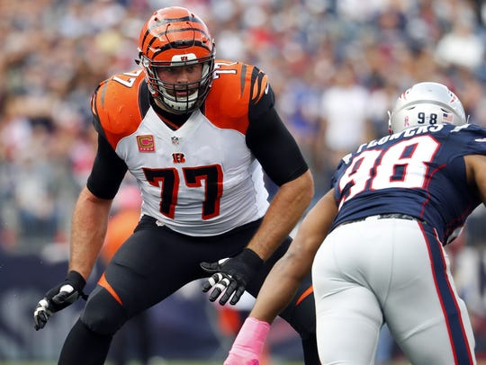 Offensive tackle Andrew Whitworth, left, signed a three-year
