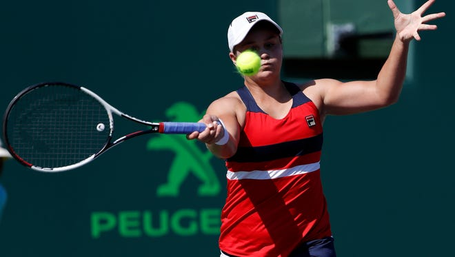 Ashleigh Barty of Australia hits a forehand against Eugenie Bouchard of Canada on Day 2 of the Miami Open.