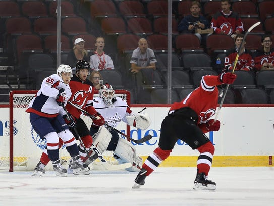 Devils right wing Kyle Palmieri takes a shot as Washington