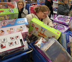Early Black Friday shoppers headed into the Toys R Us in Castleton late afternoon on Thursday, Nov. 27, 2014, to kick off the holiday shopping season. Shoppers found bargains and roadblocks in the aisles while shopping on Thanksgiving evening.
