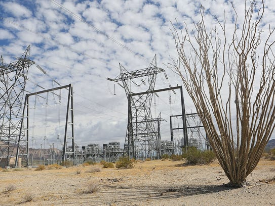 Large electricity transmission lines run along the I-10 corridor about 45 miles east of the Coachella Valley on Oct. 8, 2014.