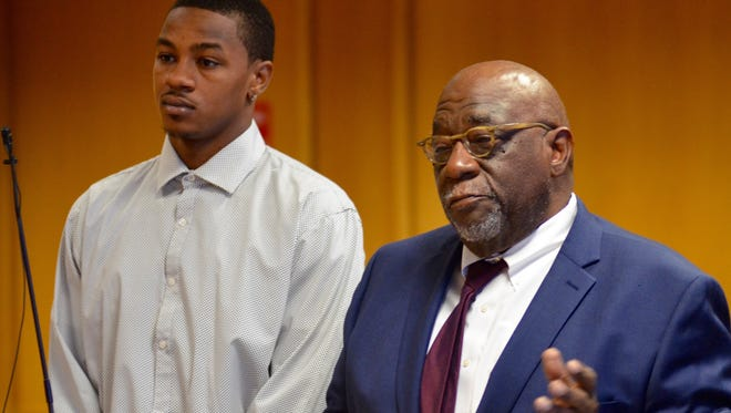 Former MSU basketball player Keith Appling and his attorney, Otis Culpepper, appear at the Frank Murphy Hall of Justice downtown today.