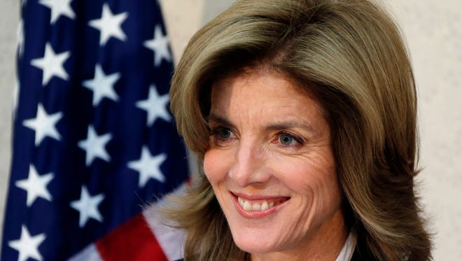 New U.S. Ambassador to Japan Caroline Kennedy smiles as she gives a statement upon her arrival in Japan at the Narita International Airport  Friday.