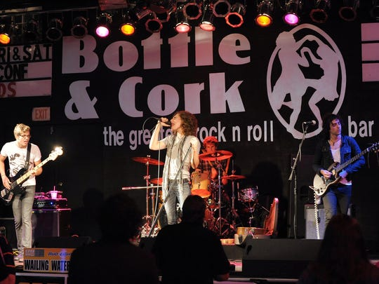 """Wailing Waters performs at Bottle & Cork during the Dewey Beach Music Conference last year. The venue's slogan will change in September. It will read, """"The greatest rock and country bar in the world."""""""