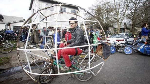 Zane Fischer sits in his hamster ball bike before a chariot race at Chariot Wars during a three-day Mini Bike Winter Olympics Feb. 18 in Portland .