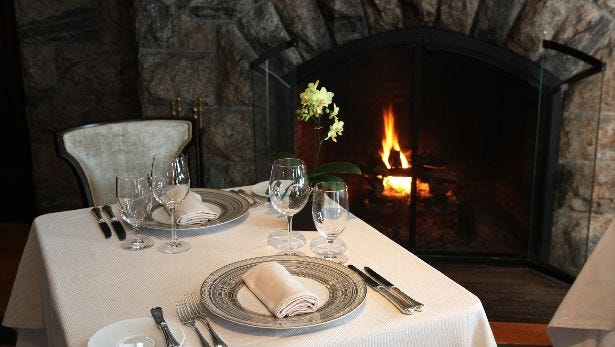 A view of one of the dining rooms and fireplace at Equus at the Castle Hotel and Spa in Tarrytown, photographed Feb. 6, 2014.
