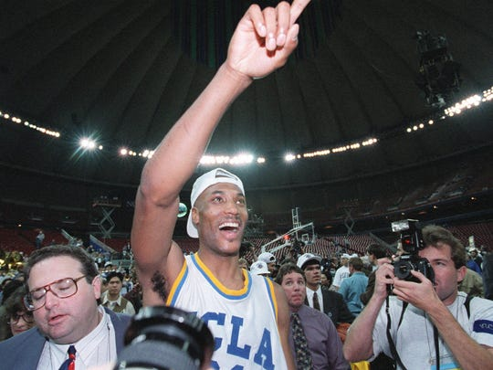 FILE - UCLA's Ed O'Bannon, wearing his National Champs cap,  is surrounded by the media April 3, 1995, after the Bruins defeated the Arkansas Razorbacks, 89-78, at the Kingdome in Seattle.