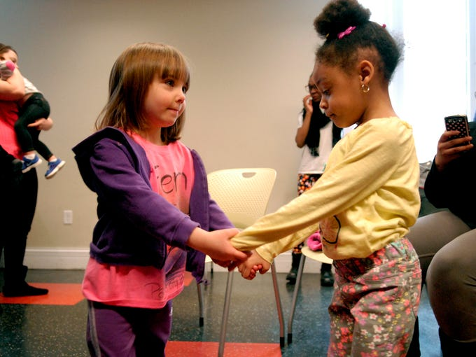 Fern Peck, 3, left, and Jade Lusco, 4, dance together during the Louisville Public Library's preschool Motown dance party in celebration of Black History Month.  Feb. 08, 2014
