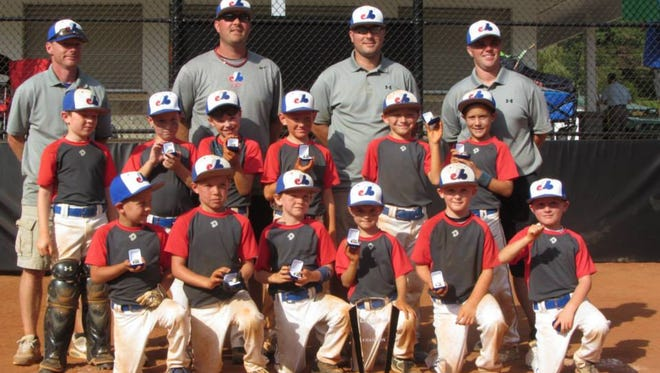 The Mountain Expos 8U baseball team and its coaches.