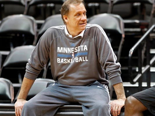 FILE - In this Feb. 24, 2015, file photo, Minnesota Timberwolves head coach Flip Saunders talks with a player during practice in Minneapolis. In a year of firsts for the Saunders family, the first Fourth of July weekend without patriarch Flip Saunders was one of the toughest. Saunders, the former president and coach of the Timberwolves, died from lymphoma in October. (AP Photo/Jim Mone, File)