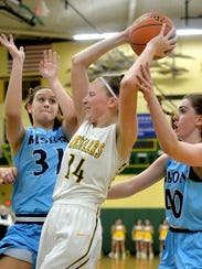 CMR's Allie Olsen protects a rebound from Great Falls