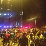 Crowds gathered early Wednesday at Stanton and Chamberlain avenues in Ames on Tuesday night of VEISHEA April 8, 2014.