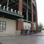 Fans lining up to purchase tickets for a football game.