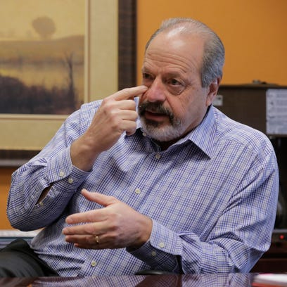 El Paso Mayor Oscar Leeser points to the spot on his