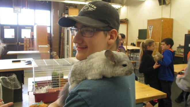 Takota Chilson was one of several SVE High School students, members of the SVE Sportsman Club and the school's Animal Science class who manned the show's petting zoo. Takota has the class chinchilla on his shoulder. The petting zoo was a popular event at the show, which drew thousands of visitors.