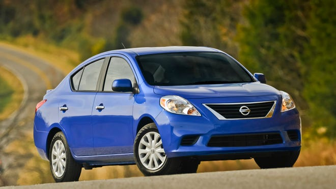 Nissan is recalling nearly 300,000 of its Versa and Versa Note vehicles to adjust a console panel that could catch the driver's shoe and slow braking speed.