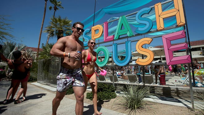 Partiers attend the Splash House pool party at the Palm Springs Hilton on Saturday.